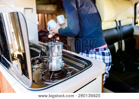 Cooking Coffee In Campervan, Caravan Or Rv On Camping Trip.