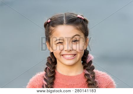 Things Gonna Be Alright. Girl Wink Cheerful Face Grey Background. Kid Girl Cheerful Satisfied With E