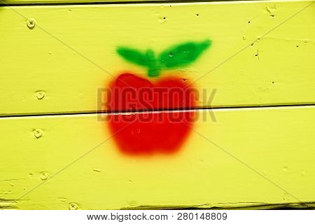 Picture Of Red Apples With Leaves In The Wooden Background