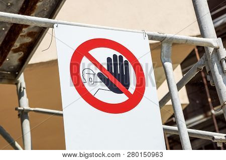 No Entry Sign On The Fence In Contruction Site With House Under Construction.