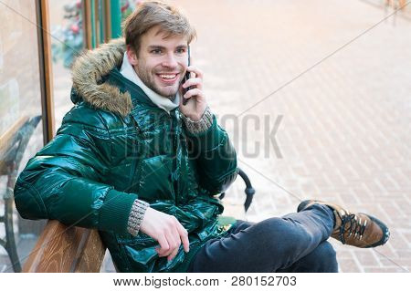 Guy Sit Bench Interact Smartphone. Communication Concept. Hipster Use Smartphone On Winter Day. Man