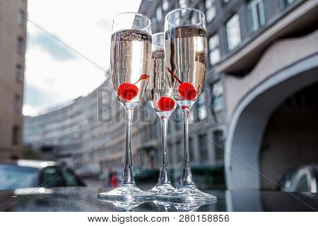 Glasses Of Champagne On The Background Of The City Building