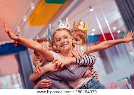 Positive Delighted Kids Lifting Happy Birthday Girl