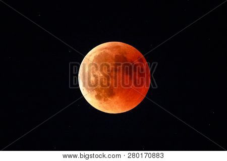 Moon Eclipse In Full Moon And Super Moon By Night. Total Lunar Eclipse With Moon Turning Red Cause O