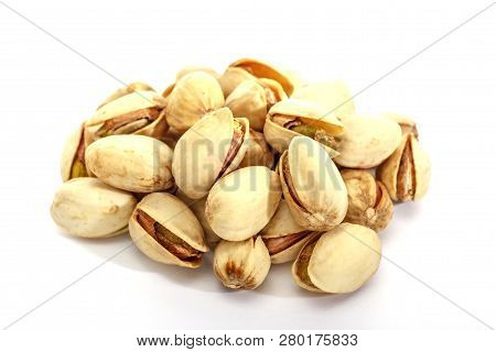 Pistachio Crude On A White Background. Isolated Group Of Pistachios.