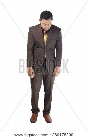 Portrait Of Asian Businessman Sad And Look Down, Concept Of Business Failure And Guilty Feeling, Ful