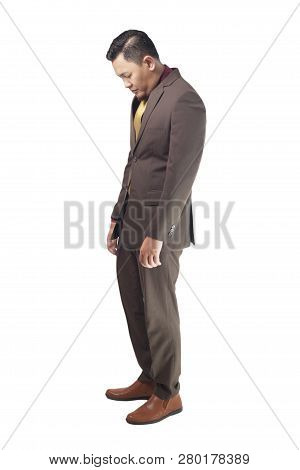 Portrait Of Asian Businessman Sad And Look Down, Concept Of Business Failure And Guilty Feeling, Sid