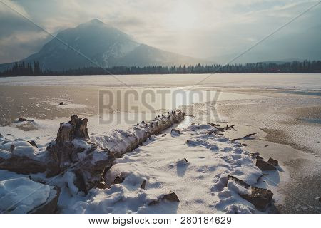Hazy Winter View Of Frozen Vermillion Lakes In Banff National Park In Alberta Canada. Snowflakes In