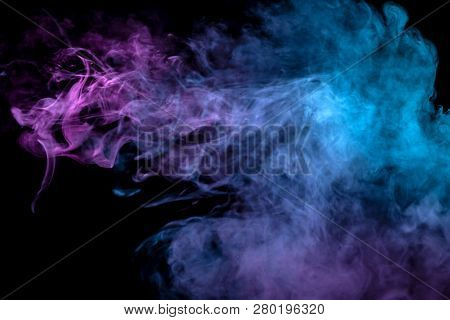 Multicolor, Thick Smoke, Illuminated By Colored In Blue, Purple And Pink Light Against A Dark Black