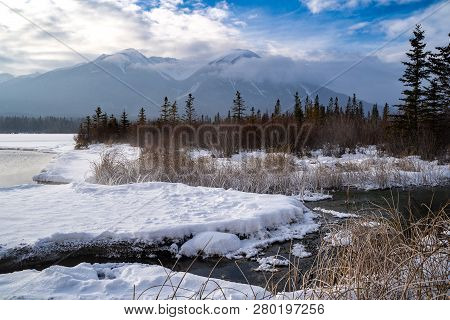Hazy Winter View Of Frozen Vermillion Lakes And Hot Springs In Banff National Park In Alberta Canada