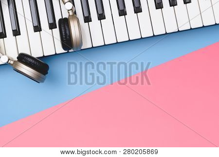 Music Keyboard Synthesizer Headphone On Blue Pink Copy Space For Music Poster Concept
