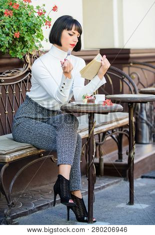 Self improvement concept. Literature for female. Mug of good coffee and pleasant book best combination for perfect weekend. Girl drink coffee read book. Woman have drink enjoy good book cafe terrace poster