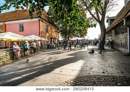 Tallinn, Estonia - September 8 2018: Tourists Line Up At The Wall Overlooking Old Town In The Upper