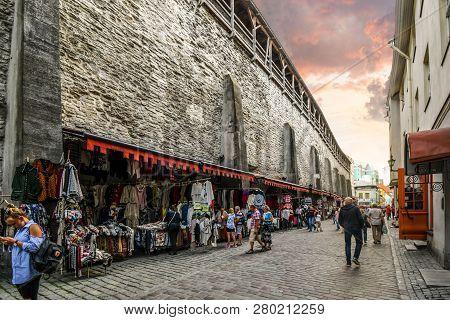 Tallinn, Estonia - September 10 2018: Tourists Shop An Outdoor Marketplace Under The Medieval City W