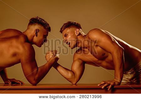 Revenge in sport. Twins men competing till victory. Twins competitors arm wrestling. Men competitors try to win victory or revenge. Strength skills. Strength and energy. poster