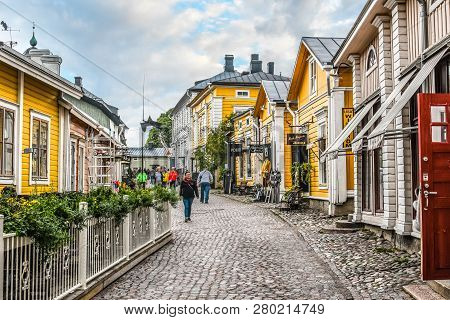 Porvoo, Finland - September 14 2018: Tourists And Local Finns Walk Past Shops Along The Cobbled Stre