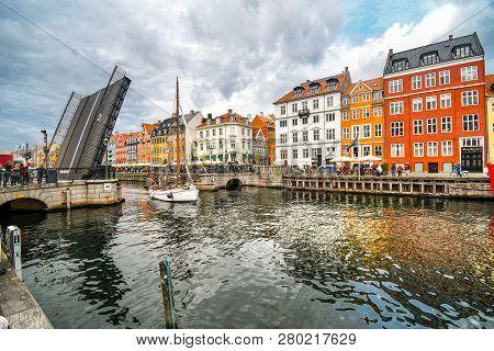 Copenhagen, Denmark - September 23 2018: The Nyhavn Bridge Opens To Let A Small Sailboat Through The