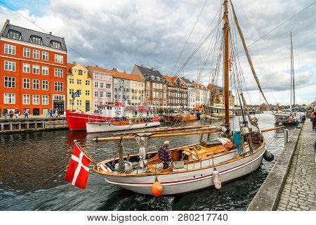 Copenhagen, Denmark - September 10 2018: An Older Man And Woman Pull Their Sailboat To The Embankmen