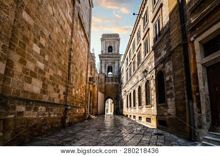 A Medieval Bell Tower With A Tunnel Opens Up To The Ancient Piazza Del Duomo In The Historic Center