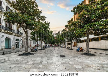 Brindisi, Italy - September 21 2018: Late Afternoon Turns To Dusk On The Piazza Della Vittoria As Fa