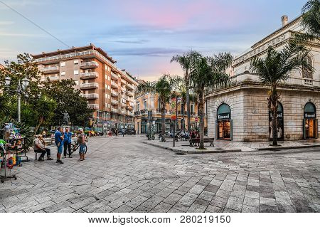 Brindisi, Italy - September 13 2018: Shops Line The Main Street, Corso Umberto, As A Group Of Older