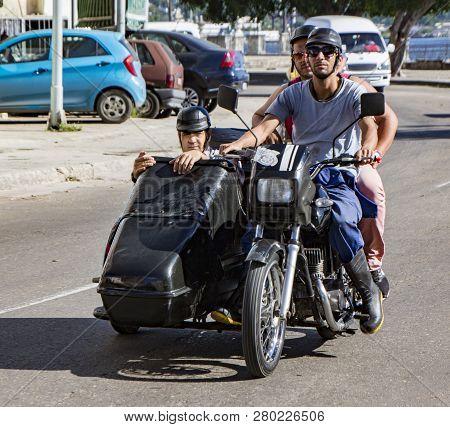 Havana, Cuba - November 19, 2011 - Three Men Ride A Motorcycle With A Sidecar