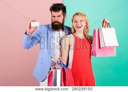 Couple With Luxury Bags In Shopping Mall. Couple Enjoy Shopping. Man Bearded Hipster Hold Credit Car