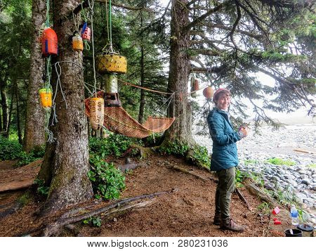 West Coast Trail, Vancouver Island, Canada - August 6th, 2016: A Young Female Hiker Smiles As She Ma