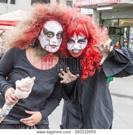 Cuenca, Ecuador - Jan 5, 2014: Two Girls Are Dressed As Ghouls For Parade