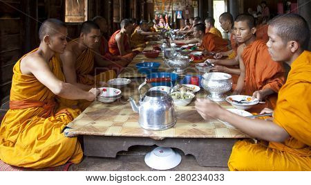 Siem Riep, Cambodia - Oct 9, 2011: Monks Have Lunch At A Temple