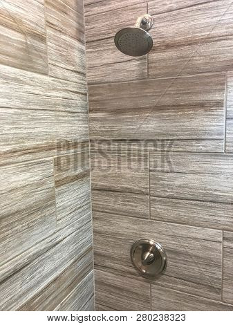 shower in bathroom. bathroom shower base. tiled shower inside bathroom. bathroom shower with full height natural stone tiles and shower fixtures