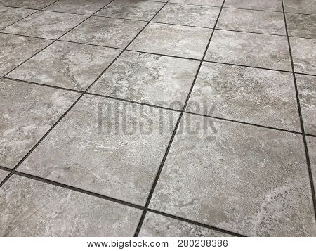 floor tile. tile floor. flooring of tiles. gray tile floor. big size of ceramic tile floor in gray color. flooring