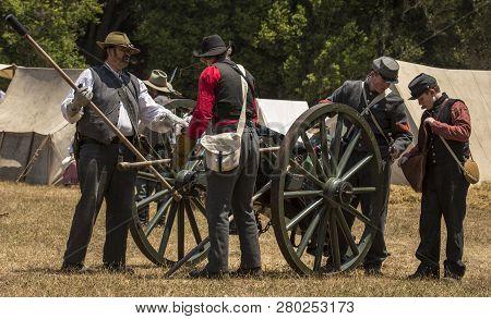 Duncan Mills, Calif - July 14, 2012: Men Prime A Canon During Civil War Reenactment