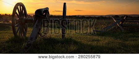 An American Civil War Cannon Sits In A Pennsylvania Field.