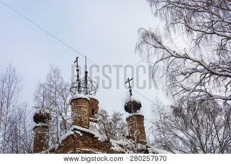 The Skeletons Of The Domes Of The Old Dilapidated Church, Covered With Snow Against The Gray Sky On