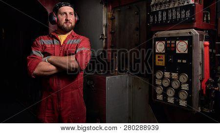 Ship Mechanic Staying Near Main Engine In Engine Room.
