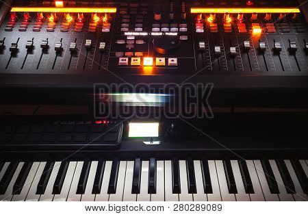 Mixing Console And Piano