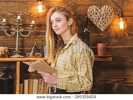 Poetry Evening Concept. Girl Reading Poetry In Warm Atmosphere. Lady On Dreamy Face In Plaid Clothes