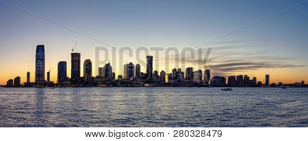 New Jersey Silhouette Panorama At Dusk, View From New York City With Hudson River In Foreground, Usa