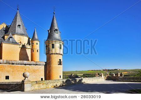 Ancient picturesque palace of the Spanish kings in Segovia and rural fields