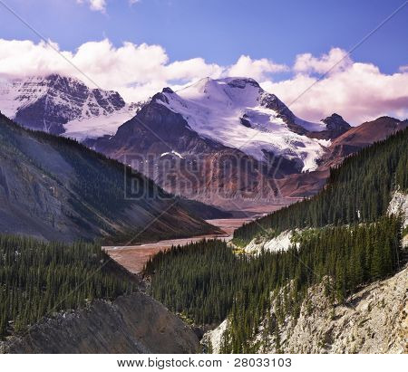 Majestic mountain landscape, glaciers and the snow slopes shined by the sun