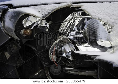 Broken Car Light Accident. Close Up Of Damaged Headlight In A Front Of Car, Winter.