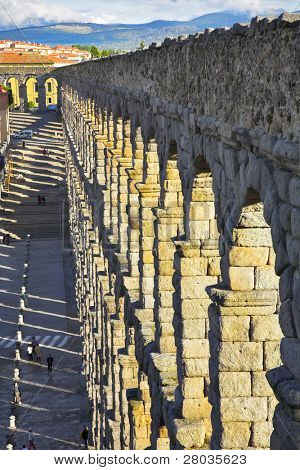 The well-known antique aqueduct and ancient Segovia in spring day