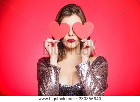 Obsession Concept. Fall In Love. Girl Adorable Fashion Model Makeup Face Hold Heart Valentines Card.
