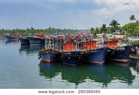 Alleppey, India, Mar 13, 2018: Fishing Boats Are Tied Up In A Row In Harbor
