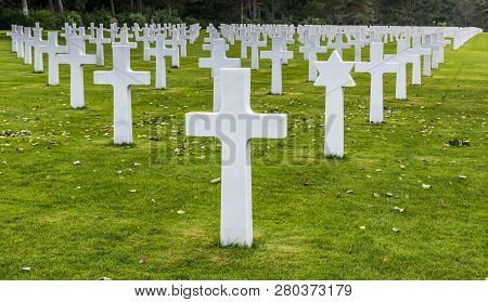 Located just above Omaha Beach at Colleville- sur-Mer, the Normandy American Cemetery was dedicated in 1956. It contains the perfectly aligned headstones of 9,387 soldiers who fell in combat poster