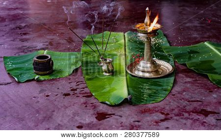 Alleppey, India, Mar 13, 2018: Incense And Flame Are Prepared On Banana Leaves As Offering For The H