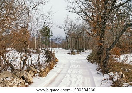 Winter Country Road. Snowy Countryside Landscape On A Cloudy Day. Bosnia And Herzegovina, Republika