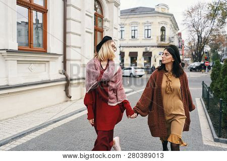 Carefree Fashionable Women Models In Elegant Autumn Clothes And Glasses. Young Fashion Girls In Styl