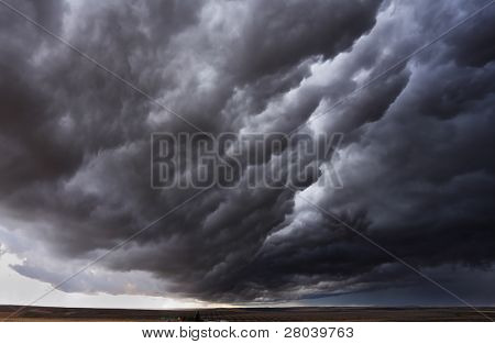The autumn storm approaches on fields after harvesting. Montana, the USA